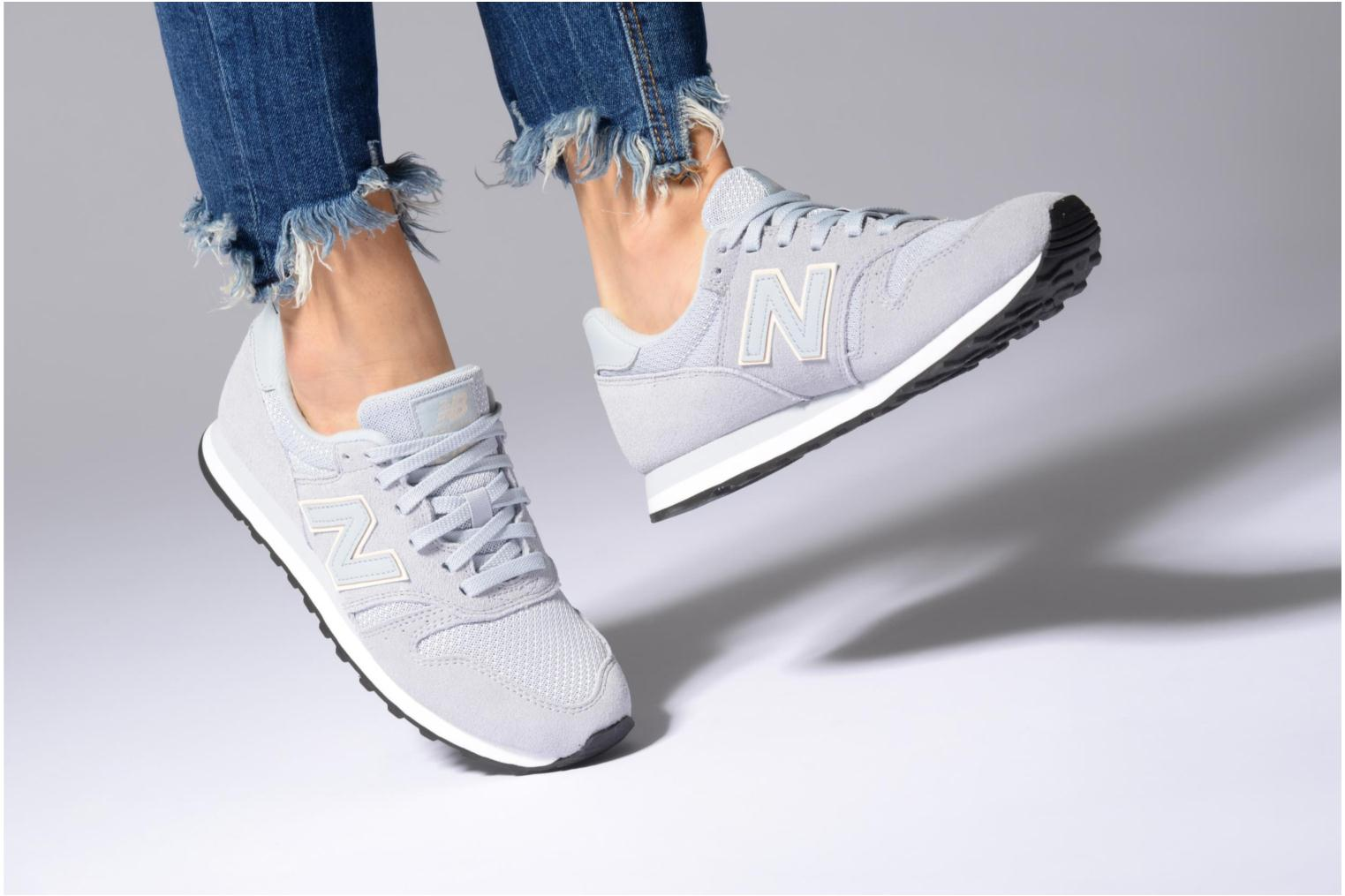 Baskets New Balance WL373 Rose vue bas / vue portée sac
