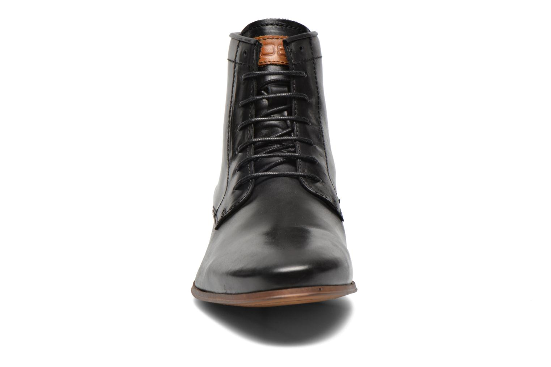 Boots Kost Guillemet Svart bild av skorna på
