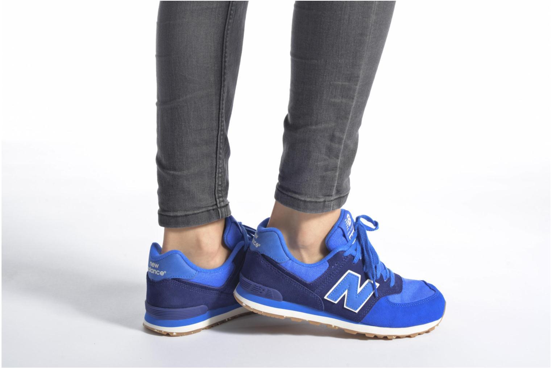 Sneaker New Balance KL574 J schwarz ansicht von unten / tasche getragen